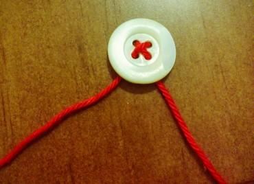 Enhebrando botones